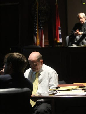 Lee Watts, center, looks down Wednesday as his attorney, Chase Smith, and Judge Ross Hicks watch a video in which Watts confesses to hitting his mother with a hammer.