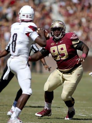 Florida State player Nile Lawrence-Stample (99) pressures Louisville quarterback Lamar Jackson (8) at Doak Campbell Stadium.