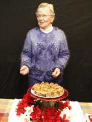 Joan Niles with Kona Banana Bread with Coconut Topping.