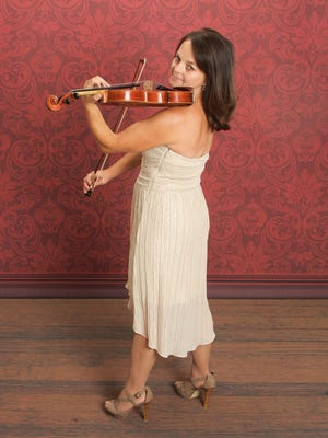 Richmond Symphony Orchestra will feature its concertmaster Mari Thomas Saturday on a violin solo.