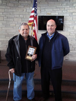 Dan Parizo, right, veteran, director of Information Technology, presented the Veteran of the Month award to John Marcin, on March 1 during a ceremony held in Marian University's coffeehouse.