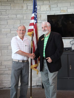 Scott Dell, right, veteran and accounting program director in the School of Business, presented the Veteran of the Month award to Richard Rupp, on May 19 during a ceremony held in Marian University's coffeehouse.