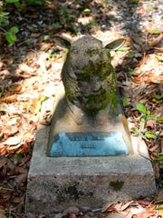 A lamb statue stands over the grave of 8-year-old Jessie