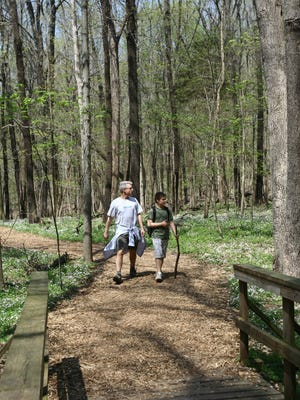 Bill Romf and son Nick hike Radnor Lake's trails during a visit to family in Nashville.