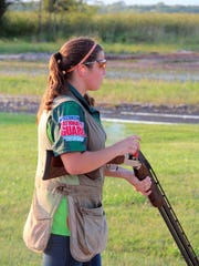 Jessie Strasser, 14, of Waterford shoots a round of trap at Boxhorn Gun Club in Muskego.