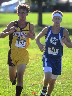 Cooper senior Michael Hoffman, left, and Covington Catholic junior Owen Piatt in the NKAC meet.