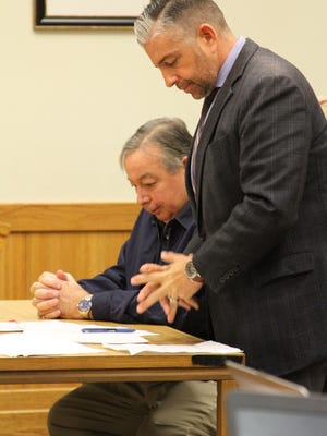 Dr. Michael Holda, left, was sentenced Thursday in Livingston County Circuit Court for delivery of a controlled substance to an undercover officer. At the table with him is defense attorney Dennis Brewer.