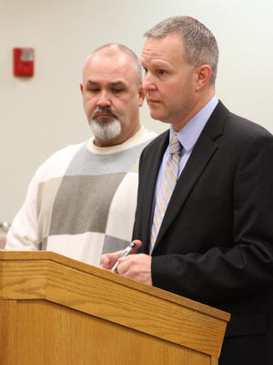 Brian Edward Everidge, left, told a Livingston County Circuit judge today that he regrets trying to return an estimated 10,000 nonrefundable bottles and cans in Michigan in April. Also pictured is Howell defense attorney Marcus Wilcox.