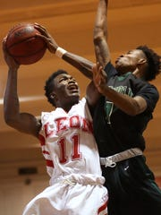 Lincoln's Jabari Richardson defends a shot by Leon's