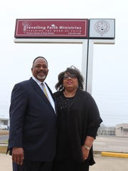 Charles and Patsy Brown stand in front of their church, Prevailing Faith Ministries.