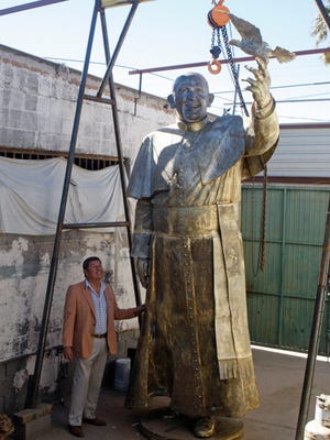 Sculptor Pedro Francisco Rodriguez is putting the final touches on the statue of Pope Francis that will be unveiled Friday.