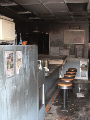 Smoke and soot damage to Mark's Midtown Coney restaurant in downtown Howell is visible to passers-by. Fire damaged the restaurant's food preparation area Thursday night.