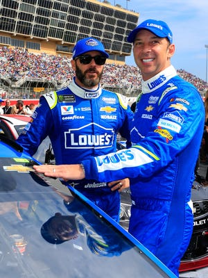 Jimmie Johnson, left, and crew chief Chad Knaus, right, have won seven NASCAR Cup Series championships together.