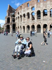 """Robert Torp-Smith and Michelle VanSlambrouck pose before the Colosseum May 8, 2017. Torp-Smith told her he wanted """"one more big trip."""""""