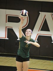 McNicholas senior Grace Turner serves to Ryle during