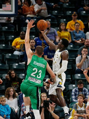 Indiana Pacers guard Victor Oladipo (4) takes a shot against Maccabi Hafia center Daniel Koperberg (23) at Bankers Life Fieldhouse.