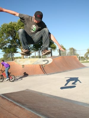 Kris Koubaddy does a trick at the skateboard park in Miracles Park in Manitowoc.
