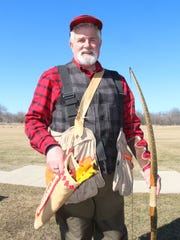 Rudy Cariello of Racine, Wis. is one of the organizers of an annual traditional archery pheasant hunt in Pleasant Prairie, Wis.