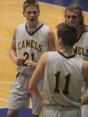 Campbell County senior Tanner Clos, 21, celebrates a big play by the Camels with Reid Jolly, 11, and Nathan Schaefer.