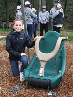 """Karis Coleman attends the installation of new """"adaptive"""" swings at Coolidge McClain Park in Silverton. The swings were added to the park after she wrote a letter to Silverton's mayor."""