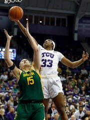 TCU forward Adeola Akomolafe (33) grabs the rebound over Baylor forward Lauren Cox (15) during the second half of an NCAA college basketball game in Fort Worth, Texas, Wednesday, Jan. 22, 2020. Baylor won 66-57. (AP Photo/Ray Carlin)