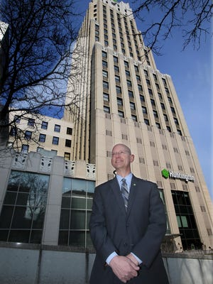 Nick Browning, Akron region president for Huntington Bank, stands outside the Huntington Tower in downtown Akron.