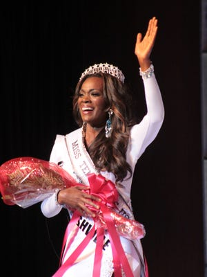 MissTennessee USA 2015, Kiara Young waves to the crowd moments after winning the title Saturday night.