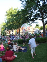 A large crowd is on hand for the June 27 Cool Kids in the Park show at Sagawa Park in Brockport.