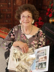 Portrait of Bonnie Bonner Rorabaugh, 86, with images of her house that she lived in as a youth at Fort DuPont from 1928-1941, Wednesday, March 26, 2014. Rorabaugh's father was a Quarter Master for Fort DuPont.