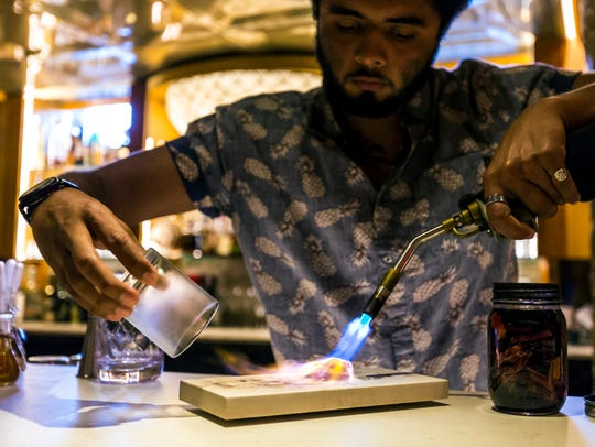 Jeffrey Oseguera, a bartender at La Cave in La Crosse,