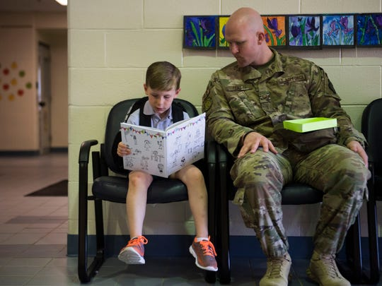 U.S. Air Force Technical Sergeant Khristian Pickett who was deployed and stationed in Tunisia and returned home yesterday, sits with his son Liam, 5, at Christian Academy of Knoxville, Thursday, May 3, 2018.