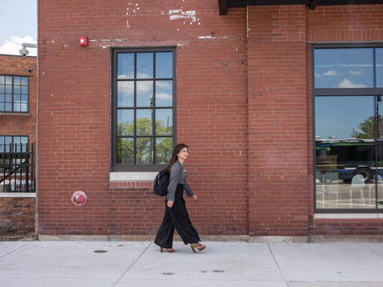 Pei-Wen Hsu of Ford Team Edison, walking into Ford's new building on Michigan Avenue in Corktown. (May 23, 2018)