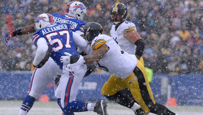 Buffalo Bills outside linebacker Lorenzo Alexander (57) is hit by Pittsburgh Steelers center Maurkice Pouncey (53) after Alexander intercepted a pass from Steelers quarterback Ben Roethlisberger during the first half Sunday.