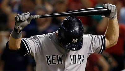 New York Yankees' Brett Gardner places the bat on his helmet after striking out against Texas Rangers' Sam Freeman leaving bases loaded in the eighth inning of a baseball game Thursday, July 30, 2015, in Arlington, Texas.