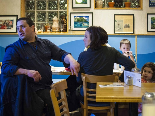 Chef Frank Pace, left, takes a break from cooking at