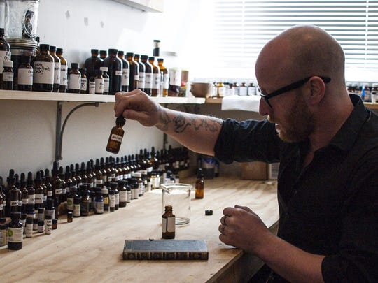 Aaron Wisniewski demonstrates how he comes up with scents at Alice & the Magician in Burlington.