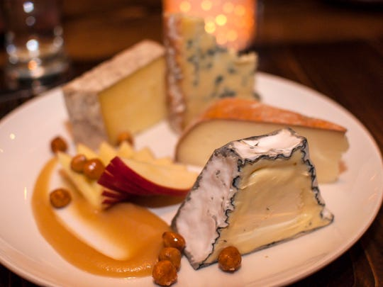 A cheese plate of Eleven Brothers, Pyramid Scheme, Landau and Madison is served before the dessert course at Hen of the Wood-Waterbury on Thursday, March 31, 2016.