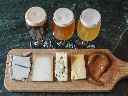 Vermont beers are paired with craft beer at Farmhouse Tap and Grill in Burlington in 2016. Collaboration between Vermont breweries and cheese-makers enhances the experience for tourists.