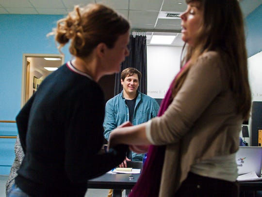 """Director Seth Jarvis, center, looks on as Chris Caswell, left, and Geeda Searfoorce rehearse Stealing From Work's production of """"History Retweets Itself"""" in Burlington on Thursday, January 12, 2017."""