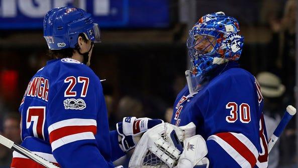 New York Rangers goalie Henrik Lundqvist celebrates