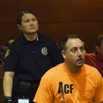 Former Guam Police Department Officer Paul Santos enters a plea of not guilty at his arraignment hearing in the Superior Court of Guam in October 2014. Santos was indicted on charges of rape, official misconduct, and abetting prostitution.