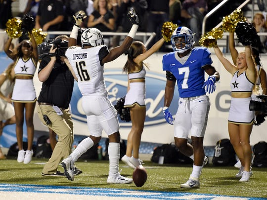 "Vanderbilt wide receiver Kalija Lipscomb (16) celebrates his second touchdown as Middle Tennessee safety Jovante Moffatt (7) walks by during the first half of an NCAA college football game at Johnny ""Red"" Floyd Stadium in Murfreesboro, Tenn., Saturday, Sept. 2, 2017."