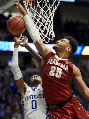 Alabama forward Braxton Key (25) goes up to block a shot by Kentucky guard De'Aaron Fox (0) in the second half of their game in the 2017 SEC Men's Basketball Tournament at Bridgestone Arena Saturday, March 11, 2017 in Nashville, Tenn.