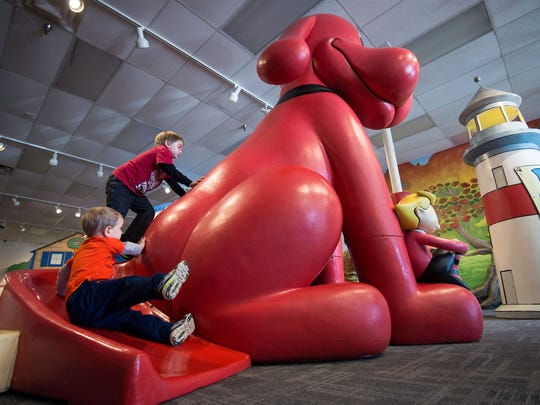Children can slide down the tail of a 9-foot Clifford