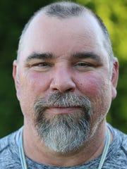 Bremerton football coach Paul Theriault