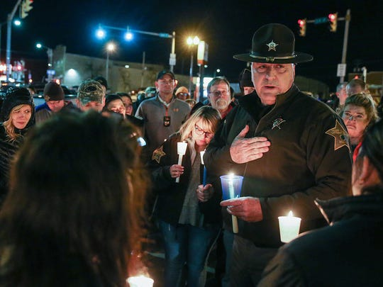 Boone County Sheriff Mike Nielsen thanks the community for its support during a vigil held for Deputy Jacob Pickett in the Lebanon Town Square on March 2, 2018.