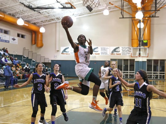 FAMU DRS senior Jazmine Jones lays the ball up past four Hernando Christian defenders in a blowout win in the Region 1-2A final.