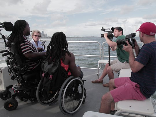 Eric LeGrand (left) interviews Jeremie Thomas, who