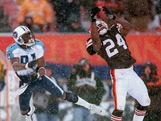 Cleveland Browns defensive back Corey Fuller (24) intercepts a pass from Tennessee Titans quarterback Steve McNair intended for receiver Chris Sanders during a game on Dec. 17, 2000.