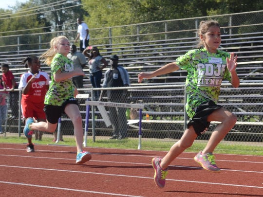 Caroline Dorman Junior High students Laryn Aymond (front) and Sydney Landry come in first and second respectively in their heat in the 50-yard dash. Both were competing in the Rapides Parish Fitness Meet held Wednesday at Alexandria Senior High School.